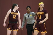 Danielle O'Banion (middle) helped coordinate the Gophers' defensive strategy.