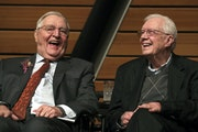 Former Vice President Walter Mondale, left, sits onstage with former President Jimmy Carter during a celebration of Mondale's 90th birthday on Jan.