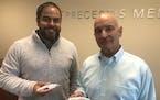 Chief Financial Officer Joe Delgado, left, and Chief Executive Steve Anderson of Preceptis show the Hummingbird device.