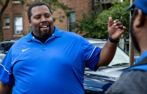 Minneapolis North football coach Charles Adams