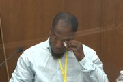 In this image from video, witness Donald Williams wiped his eyes as he answered questions during Derek Chauvin's trial.