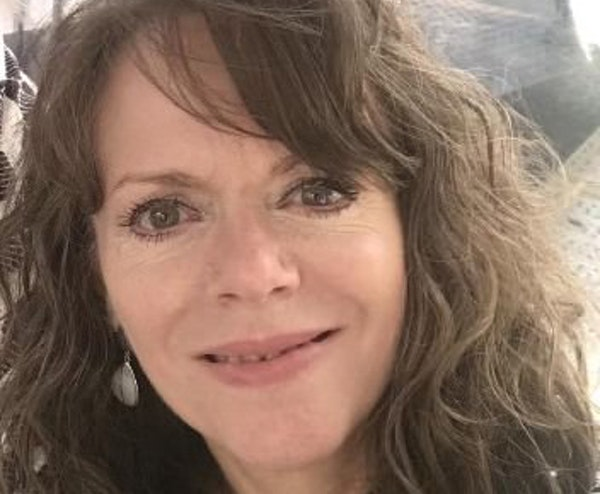 Lisa Hanson is charged with keeping her wine bar open for six days in December and January in violation of Gov. Tim Walz's emergency order.