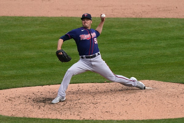 Minnesota Twins relief pitcher Caleb Thielbar throws during the eighth inning of a baseball game against the Detroit Tigers, Tuesday, April 6, 2021, i
