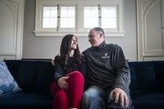St. Thomas men's basketball coach Johnny Tauer and his wife Chancey posed for a portrait in their St. Paul home.