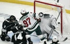Minnesota Wild's Kirill Kaprizov watches the puck enter the net past Los Angeles goaltender Calvin Petersen for a goal during the first period Frida