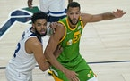 Timberwolves center Karl-Anthony Towns battles for positioning with Utah center Rudy Gobert on Saturday.