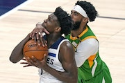 Utah guard Mike Conley defended against Wolves rookie Anthony Edwards in the first half Saturday night in Salt Lake City.