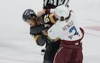 Vegas' Keegan Kolesar and Colorado's Dan Renouf fought during a game in Denver last month.