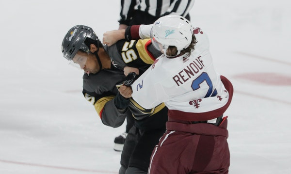 Vegas' Keegan Kolesar and Colorado's Dan Renouf fought during a game in Denver last month.