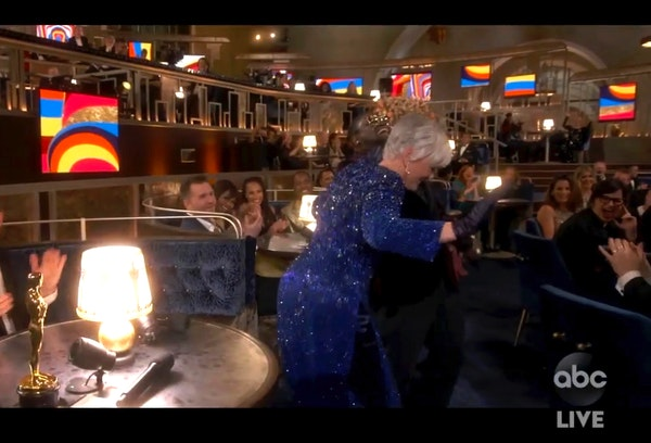 """In this video image provided by ABC, Lil Rel Howery reacts as Glenn Close dances to E.U.'s """"Da Butt"""" in the audience at the Oscars on Sunday, Ap"""