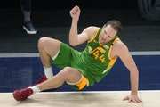 Jazz forward Bojan Bogdanovic fell after making a three-pointer against the Wolves on Saturday night.