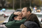 Damen Adams Jr., 13, left, a Plymouth Middle School student, was reunited with his father Damen Adams Sr., after a student fired gunshots on Monday, A