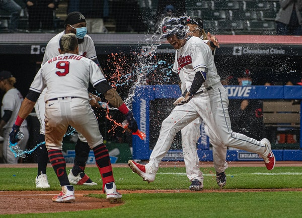 Cleveland's Jordan Luplow got drenched by Eddie Rosario and his teammates after hitting a two-run home run off Twins reliever Alexander Colome in th
