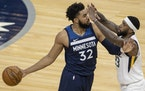 Karl-Anthony Towns (32) of the Minnesota Timberwolves was defended by Royce O'Neale (23) of the Utah Jazz fought for the ball in the second quarter.