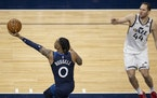 D'Angelo Russell (0) of the Minnesota Timberwolves made the go-ahead basket in the final seconds of the game as Bojan Bogdanovic (44) watched.
