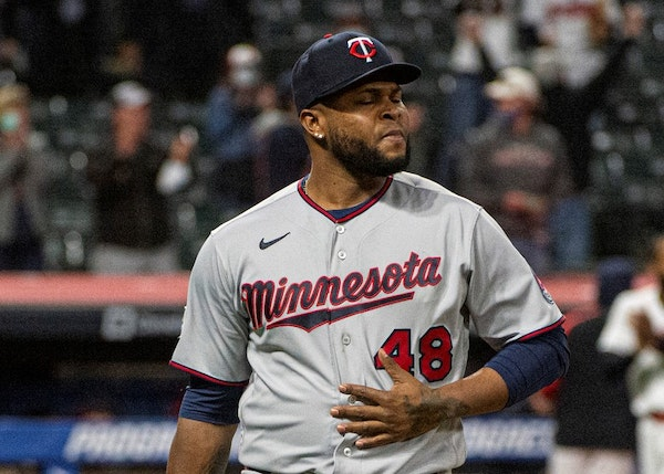 Minnesota Twins relief pitcher Alex Colome walks to the dugout after Monday's loss.