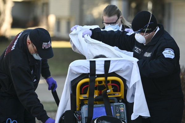 A woman, having a suspected COVID-19 related medical emergency, was helped by emergency first responders in the north Twin Cities metro in December.