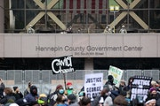 People gather outside the Hennepin County Government Center waiting for the verdict in the murder trial of former Minneapolis police officer Derek Cha