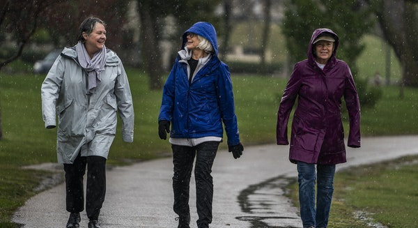 "From left, Lisa Feese Burns, Kristine Palm and C.T. Brasch enjoyed a walk together with no masks Tuesday at Lake of the Isles. ""It's wonderful not"