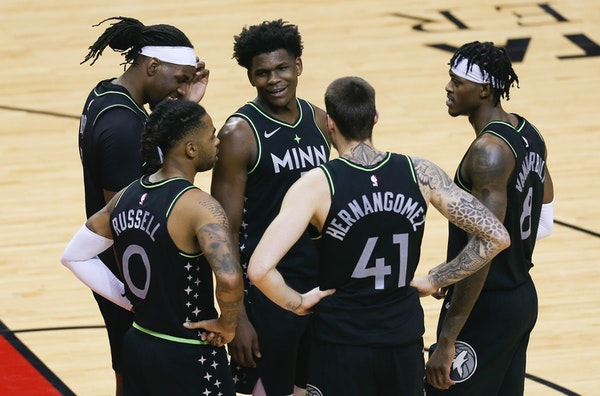 Minnesota Timberwolves forward Anthony Edwards and teammates huddle as time runs down during the fourth quarter of the team's win over Houston.