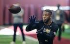 Minnesota wide receiver Rashod Bateman makes a catch during Minnesota NFL football Pro Day.
