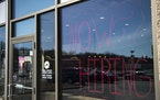 """FILE-A Pizza Hut on Central Avenue in Duluth with """"Now Hiring"""" spray painted in it's front window. Both job vacancies and unemployment are high"""