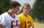 Kirk Cousins, right, during Washington's training camp of his rookie season in 2012.