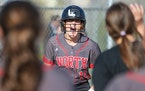 Lakeville North's Jordan Ahrenstorff (19) celebrates her game-tying home run in the bottom of the seventh inning against Rosemount Wednesday evening