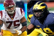 Offensive lineman Alijah Vera-Tucker of USC (left) and defensive lineman Kwity Paye of Michigan  are draft targets for the Vikings.