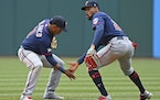 Byron Buxton and Jorge Polanco, who both hit homers in the first inning, celebrated after Wednesday's Twins victory.