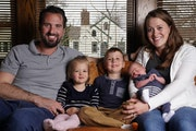 Chris Bernard and his wife, Britt, with their  children Eleanora, 2, Gideon, 4, and Conrad, 1 week old, at their home in northeast Minneapolis. The th