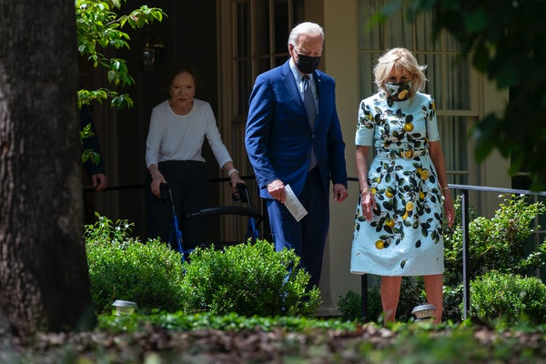 Former first lady Rosalynn Carter looks on as President Joe Biden and first lady Jill Biden leave the home of former President Jimmy Carter during a t