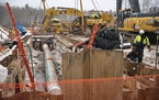 Shown are workers laying down pipe for the Line 3 project in February in Cloquet. (ALEX KORMANN, Star Tribune)
