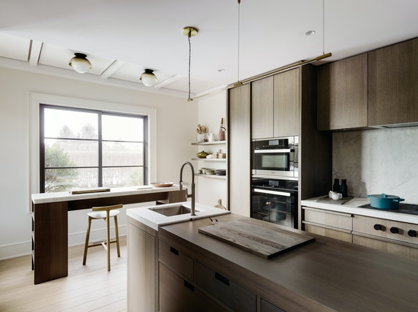 Changing out cabinet fronts is an investment, but it's a worthy one; pick classic wood finishes, such as walnut, and stay away from yellow or pink-r