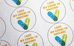 Stickers for those vaccinated wait in the observation room in Community Health Services to be handed out post-vaccination in Aspen, Colo., Wednesday,