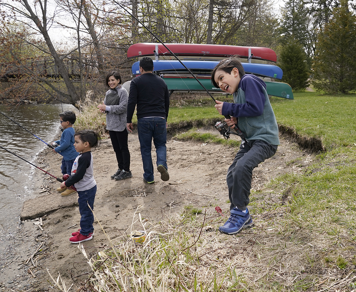 Jared Cuevas, middle right, and his wife, Elsa Sanchez, middle left, fished with twin sons Aaron and Eric, both 5, and Ian, 8, right.