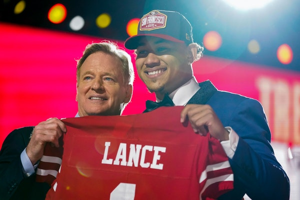 Trey Lance with NFL Commissioner Roger Goodell Thursday night at the NFL draft in Cleveland.