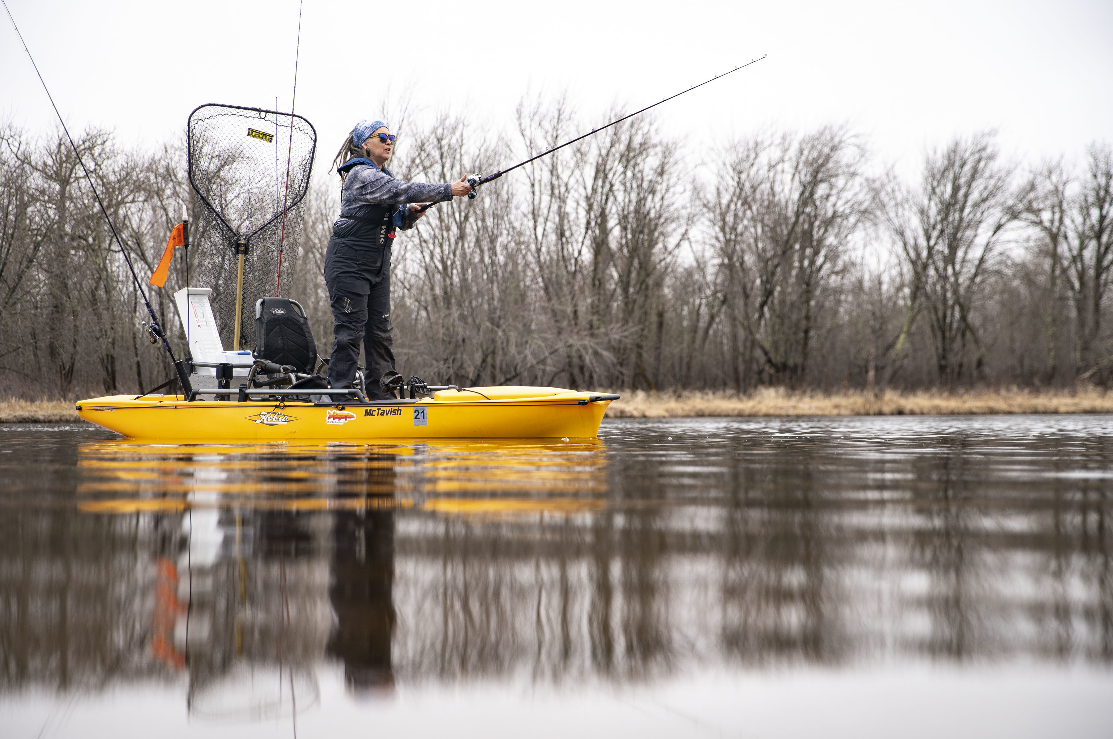 Karen McTavish takes a practice cast on the St. Louis River in Saginaw, Minn.