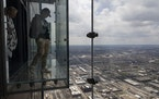Visitors explore The Ledge glass boxes on the 103rd floor of the remodeled Skydeck on April 21, 2021, at Willis Tower in Chicago.