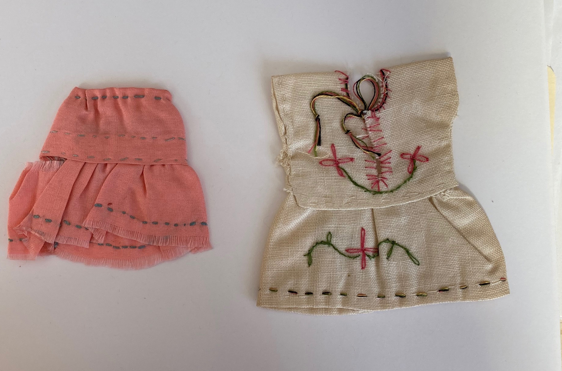 Doll clothes found in a book.