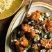 """Tomato-Braised Cauliflower with Feta and Mint from """"Milk Street: Tuesday Nights Mediterranean."""""""