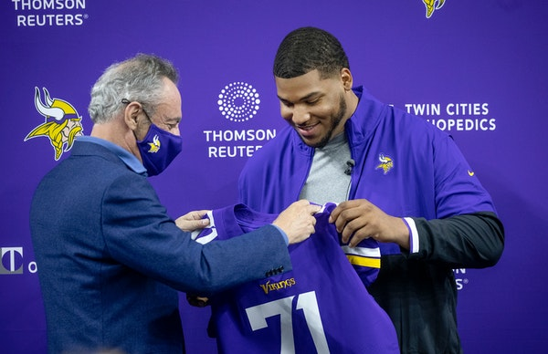 Vikings owner Zygi Wilf with first-round draft pick Christian Darrisaw on Friday.