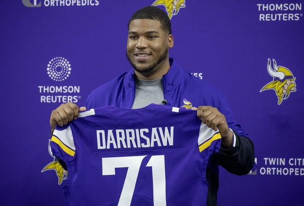 Vikings' first-round draft pick Christian Darrisaw from Virginia Tech was all smiles as he was introduced with the No. 71 jersey at TCO Performance
