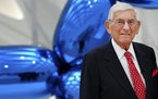"""Eli Broad poses for a photo at his museum, """"The Broad"""" in downtown Los Angeles in 2015. Broad died Friday at age 87."""