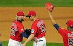 Twins first baseman Alex Kirilloff and Josh Donaldson celebrate after they defeated the Kansas City Royals