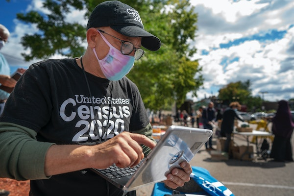 Census worker Daniel Crawford gathered information from a person in the Cedar-Riverside area of Minneapolis in September.