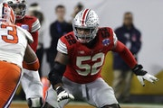 At 6-4 and 315 pounds, guard Wyatt Davis, a third-round pick by the Vikings, personifies the type of offensive lineman coach Mike Zimmer values.