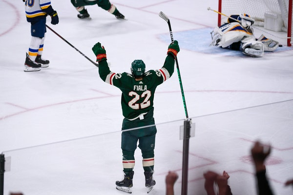 Wild left wing Kevin Fiala celebrates after scoring past St. Louis Blues goalie Jordan Binnington to win in overtime Saturday night.
