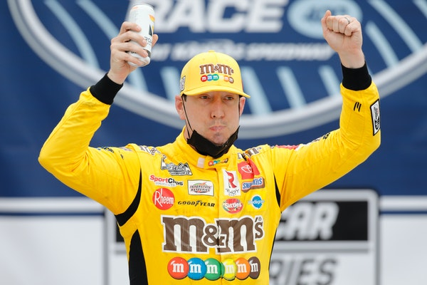 Kyle Busch celebrated in Victory Lane after winning a NASCAR Cup Series race at Kansas Speedway on Sunday.