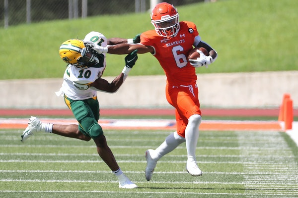 Sam Houston State running back Noah Smith tried to fight off North Dakota State safety Dom Jones for extra yardage as he ran around end during the thi